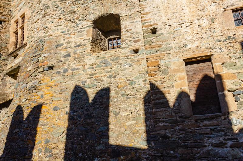 the facade of the castle of Fenis in Aosta Valley with its city walls and its defensive towethe facade of the castle of Fenis stock images