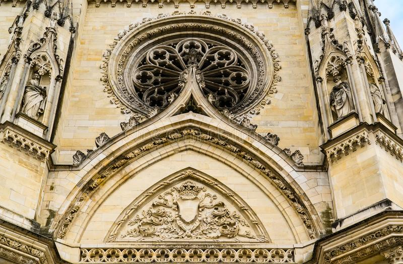 Facade of Cathedral of the Holy Cross of Orleans, Loire Valley,. Orleans, France: Detils of the carvings above the entrance doors of the Cathedral of the Holy stock photo