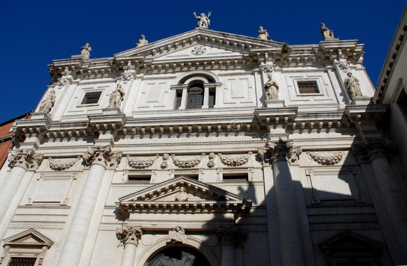 Facade of the church with nine statues in Venice. royalty free stock photo