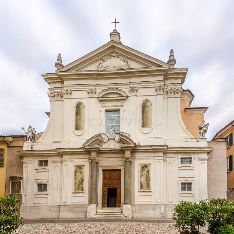 Facade of Church Santa Maria della Carita in the streets of Brescia in Italy. Facade of Church Santa Maria della Carita in the streets of Brescia - Italy stock photo