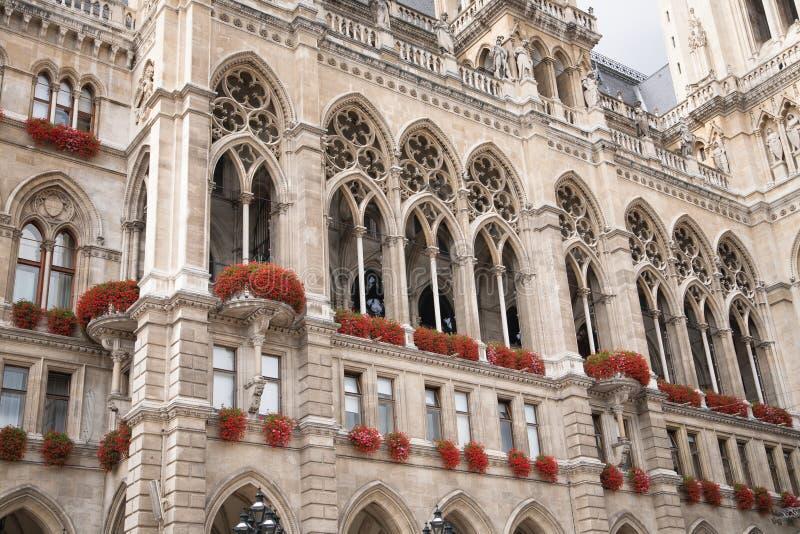 Facade of cityhall historic building in Vienna. Neo-gothic facade and balcony of cityhall historicism building in Vienna, Austria stock photo