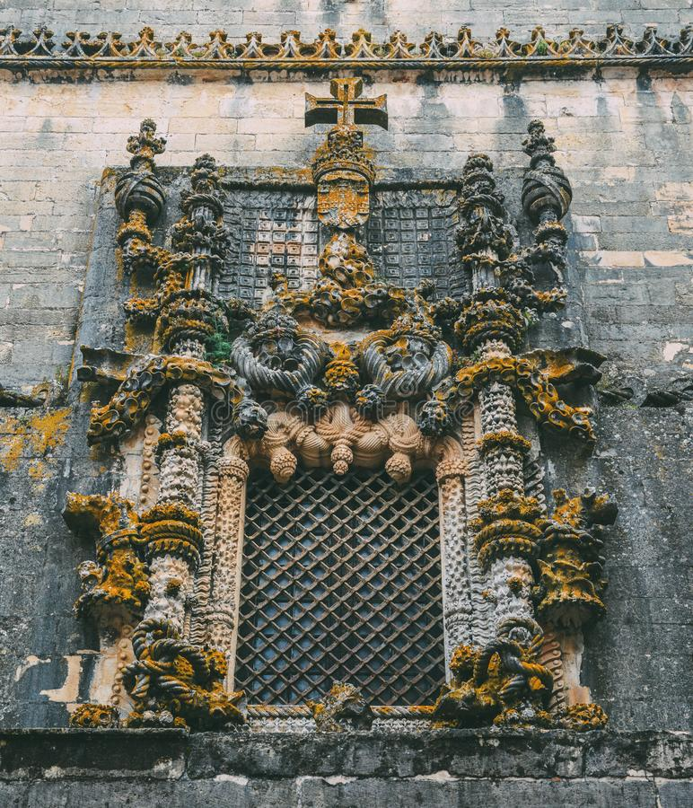 Facade of the Convent of Christ with its famous intricate Manueline window in medieval Templar castle in Tomar, Portugal royalty free stock photos