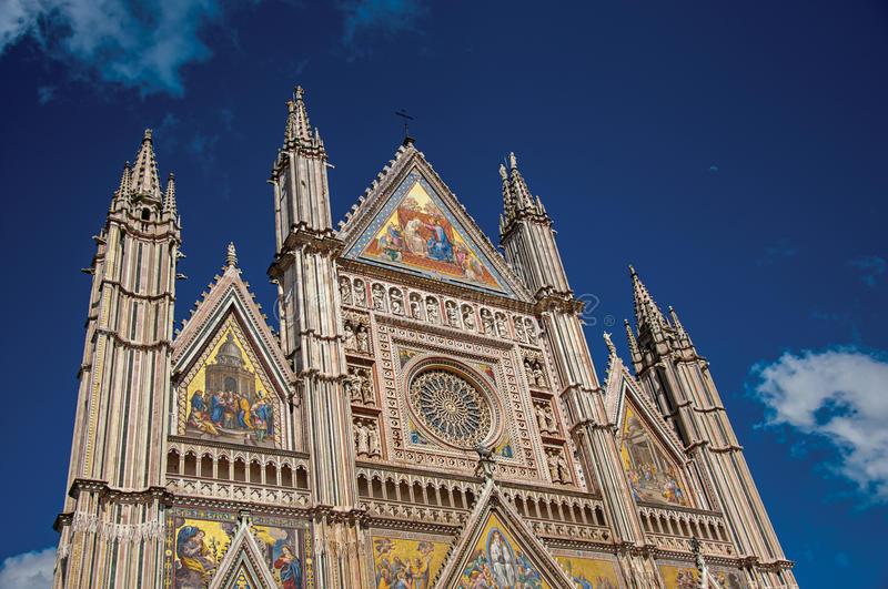 Facade details of the opulent and monumental Orvieto Cathedral in Orvieto. Facade details of the opulent and monumental Orvieto Cathedral Duomo under sunny blue stock photo