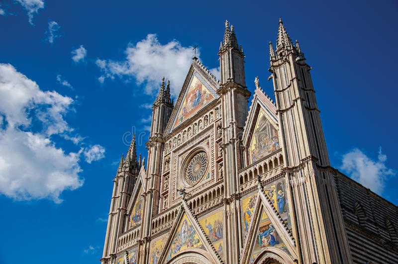 Facade details of the opulent and monumental Orvieto Cathedral in Orvieto. Facade details of the opulent and monumental Orvieto Cathedral Duomo under sunny blue royalty free stock photos