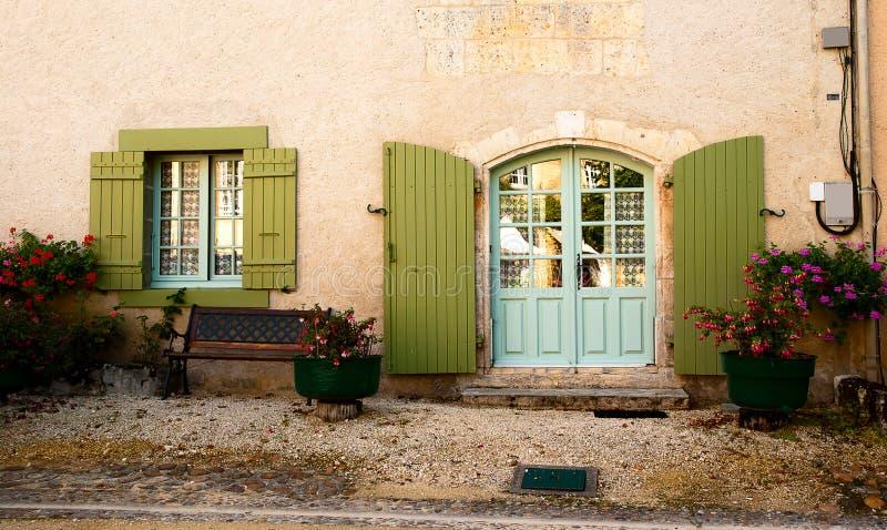 Facade door window bench flowers stock photos