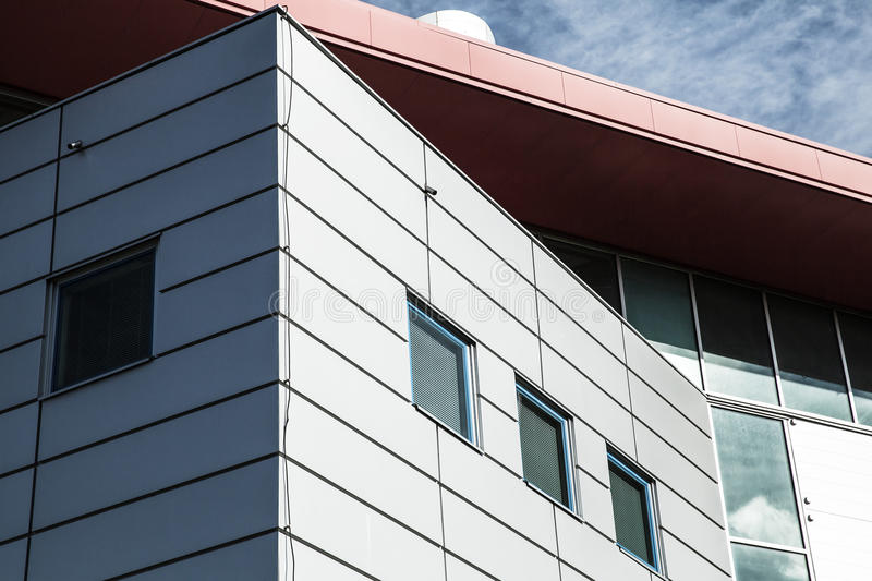 Facade of factory building with red roof stock photography