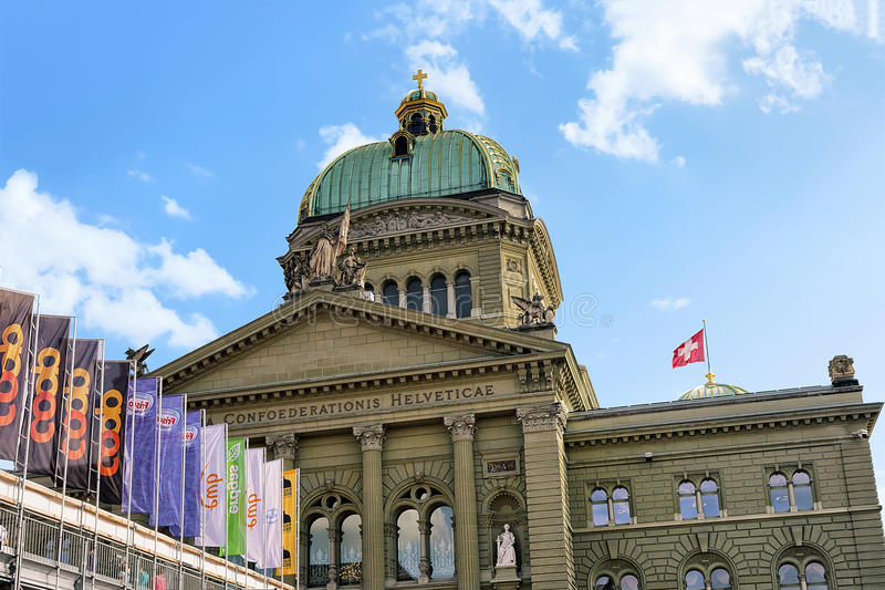 Facade of Federal Palace of Switzerland towers and flag Bern royalty free stock photography