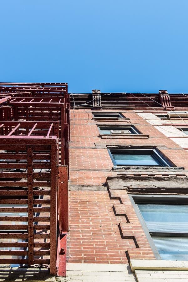Facade and fire escape of pre-war walkup apartment building royalty free stock photos