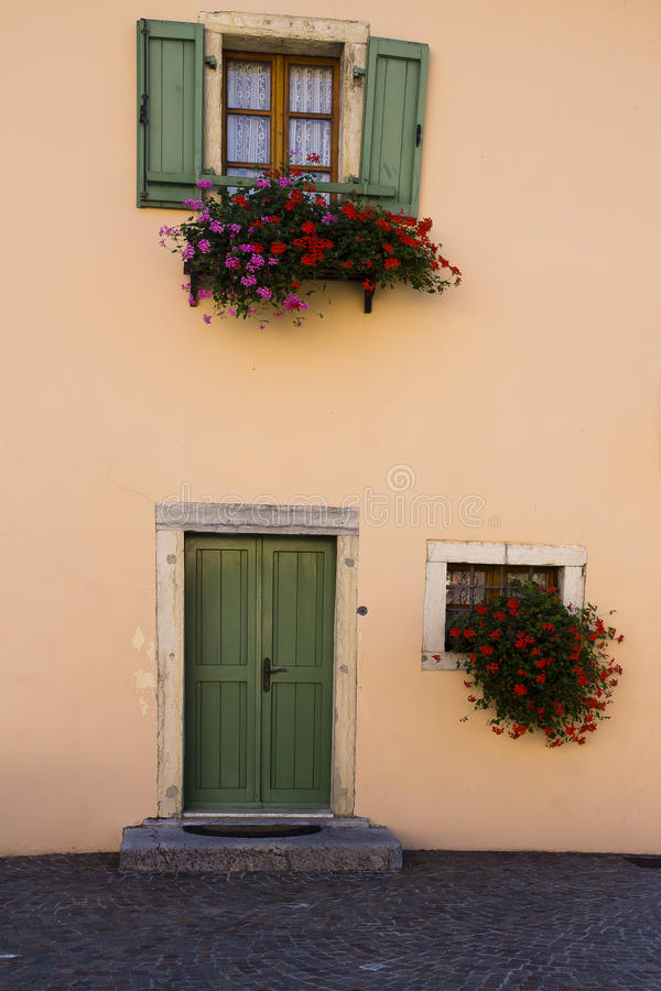 Facade and flowers, Torbole, Italy royalty free stock photography