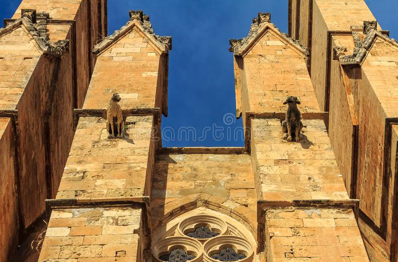 Facade with gargoyles of the Cathedral of Santa Maria of Palma stock image