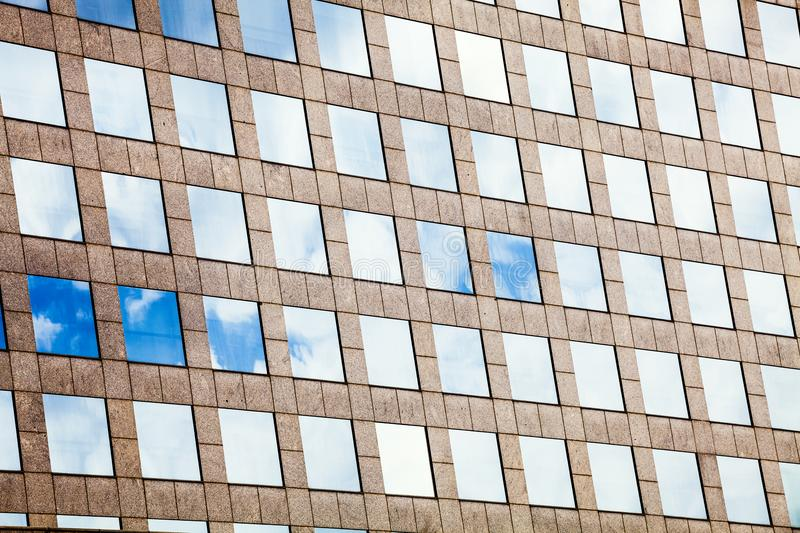 Facade glass windows with sky reflected. Modern office building. royalty free stock image