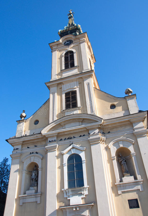 Facade and glided tower of the Neo Baroque church in Zemun. Facade with the clock and glided tower of the Neo Baroque church in Zemun, Serbia, in the early stock photography