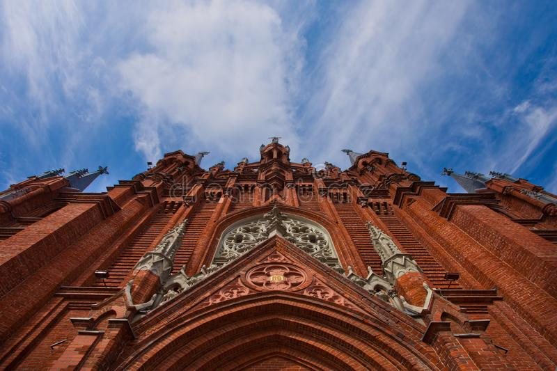 Facade of a Gothic cathedral rests against a blue sky royalty free stock photo