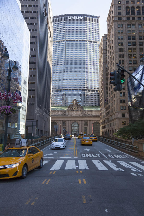 Facade of grand central station in new york city with yellow cab stock photo