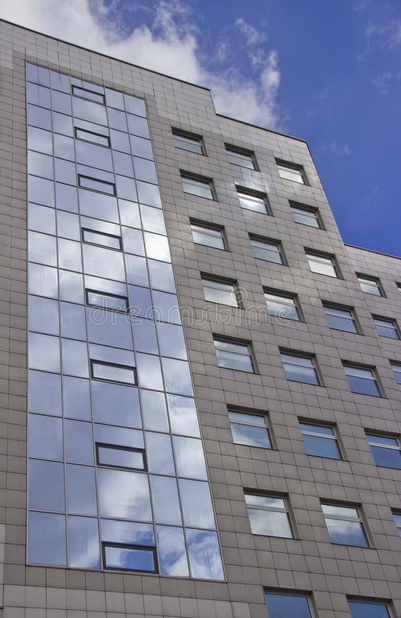 The facade of a high multi-storey building. Against the sky stock photo