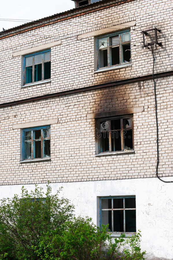 Facade of highrise house after an explosion stock image