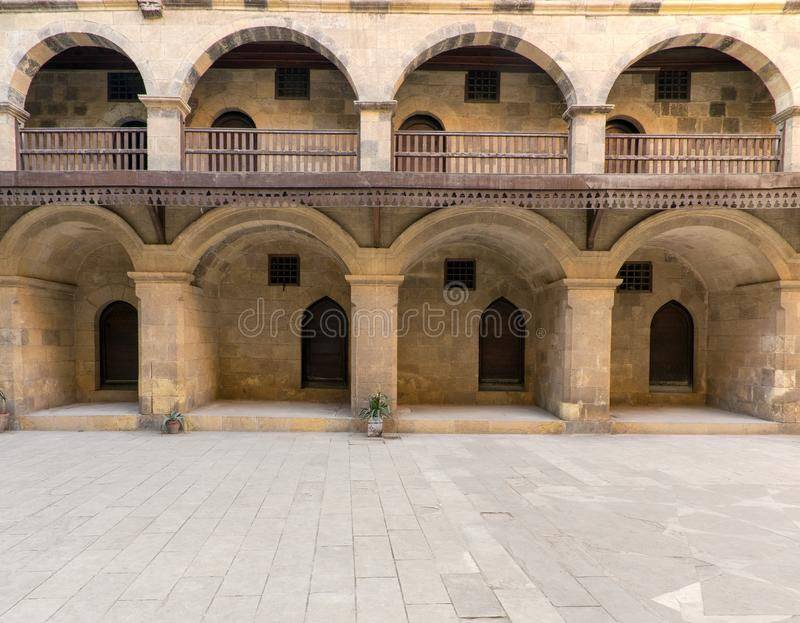 Facade of caravansary of Bazaraa, with vaulted arcades and wooden oriel windows, Cairo, Egypt. Facade of historic Wikala of Bazaraa building, with vaulted royalty free stock image