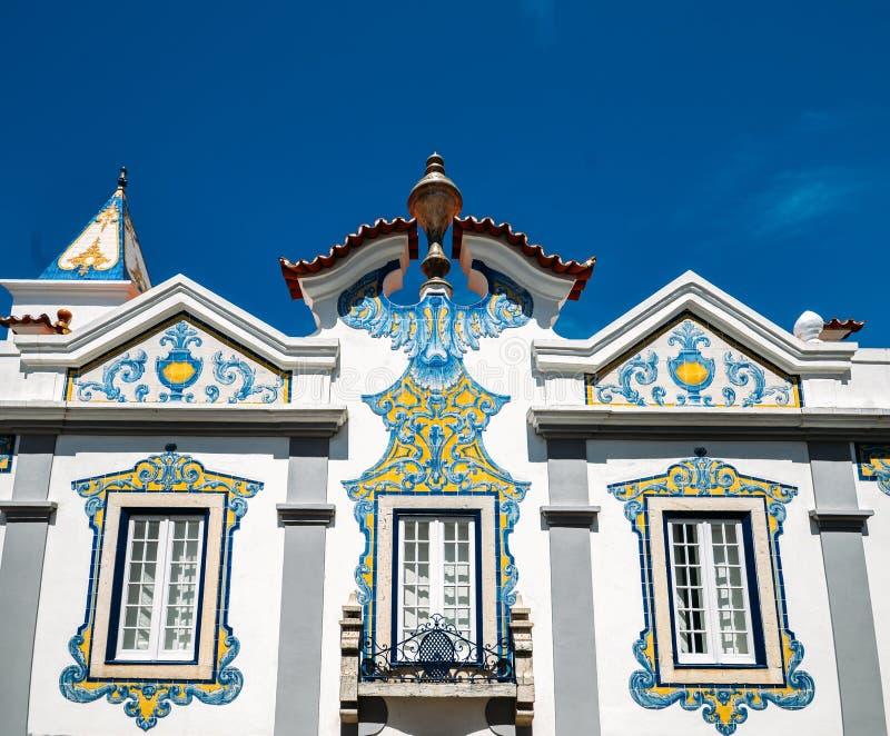 Facade of house covered in blue Portuguese style azulejo tiles in Cascais, Portugal. Cascais, Portugal - May 3rd, 2019: Facade of house covered in blue stock photos