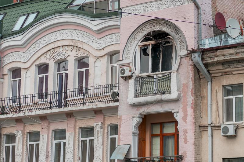 Facade of the house after the fire. Blackened from soot wall around the burnt-out apartment. Flames damaged the windows stock image