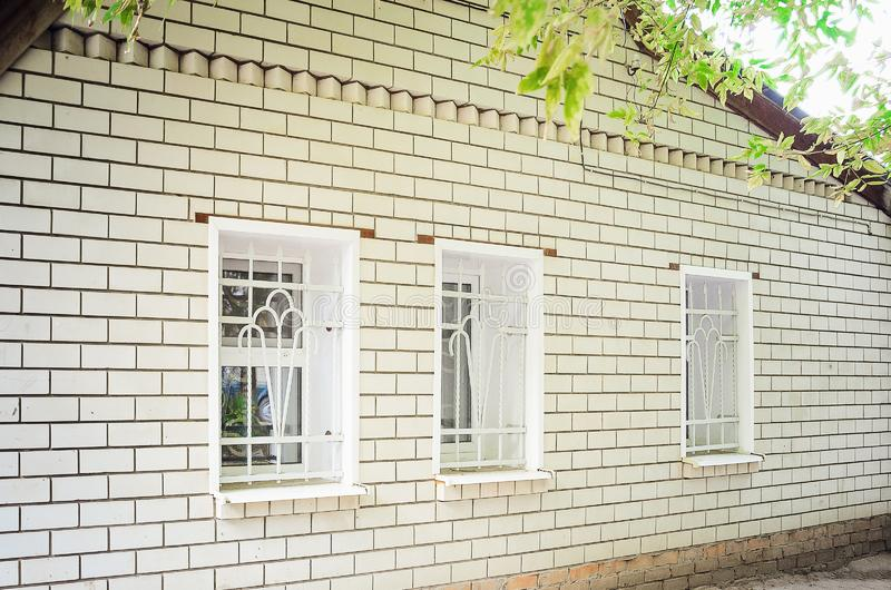 The facade of the house is made of white bricks. Close-up royalty free stock photo