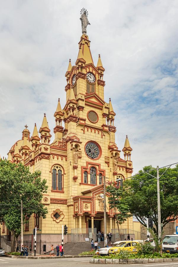 Facade of Jesus of Nazareth Church in Medellin, Colombia. Medellin, Colombia - March 24, 2018: People entering Jesus of Nazareth Church in Medellin, Colombia royalty free stock images