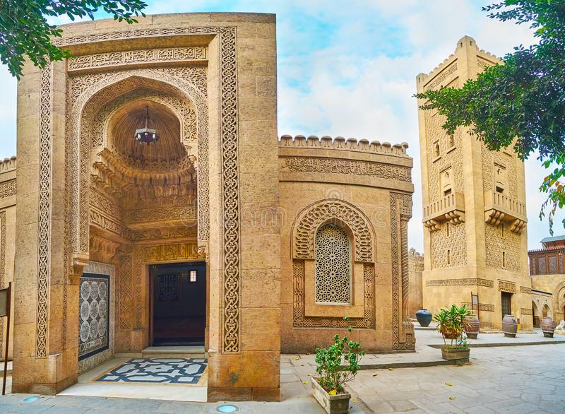 The facade of Manial Palace mosque, Cairo, Egypt. The facade of Manial Palace mosque with masterpiece carved patterns of the iwan portal, Arabian screens on royalty free stock images