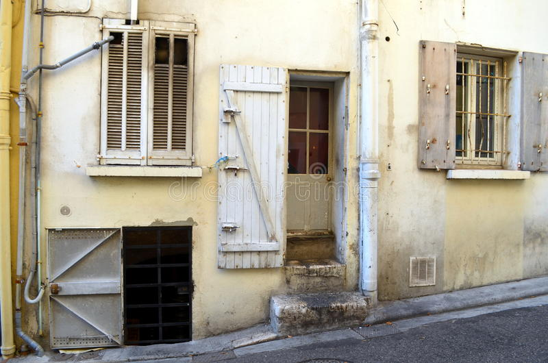 Facade with many doors and windows of a french building. Facade with lots of doors and windows of a typical french building stock image