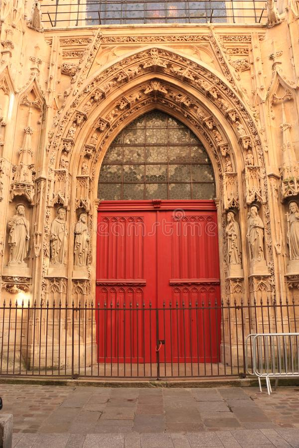 Red door of the medieval church royalty free stock photography