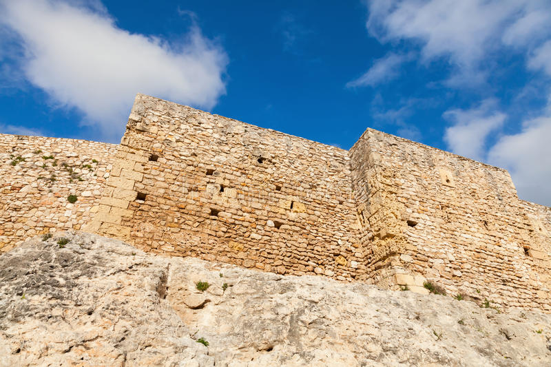 Facade of medieval fortress. Calafell, Spain. Facade of medieval stone fortress. Main landmark of Calafell, Spain royalty free stock image
