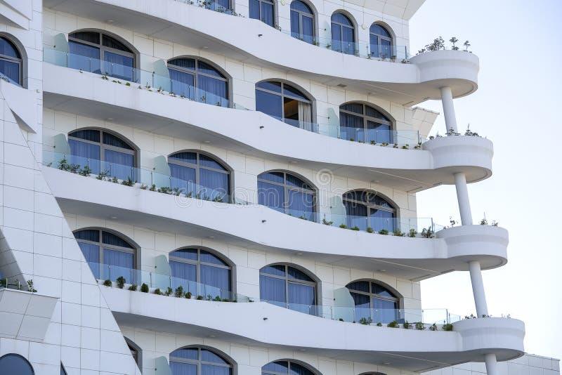 Facade of a modern apartment building, exterior and architecture design concept. Facade of a modern apartment building. Lines patterns of facade with balcony of stock image