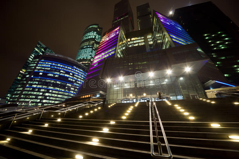 Facade of modern office building at night stock images