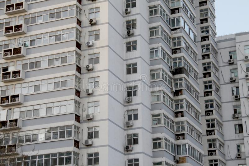 Facade of modern residential high rise building with lots of windows and apartments stock image