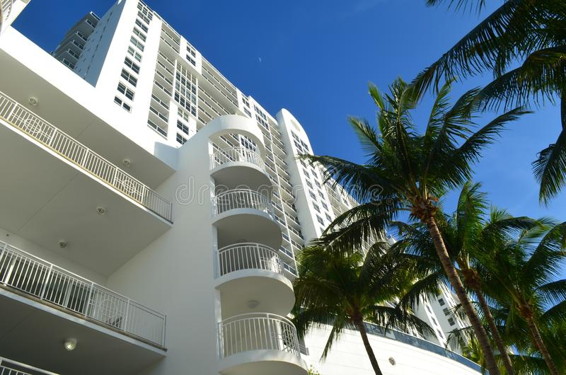 Facade of Modern Southbeach Condo Tower. Exterior design of a luxury condominium high-rise landscaped with palm trees in Miami Beach,Florida royalty free stock photo
