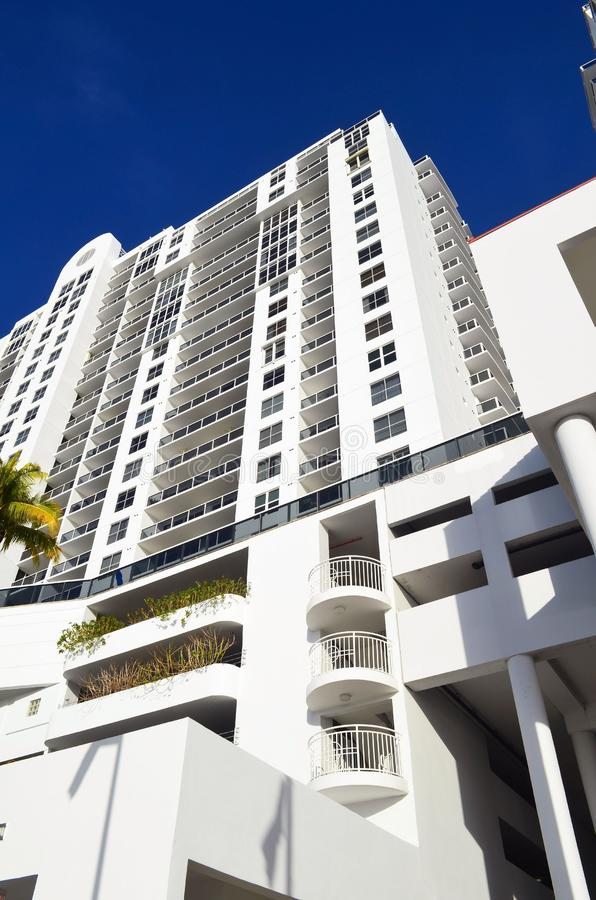 Facade of Modern Southbeach Condo Towere. Exterior of an all white modern luxury condominium in the southbeach section of Miami Beach on raw shores of the stock image