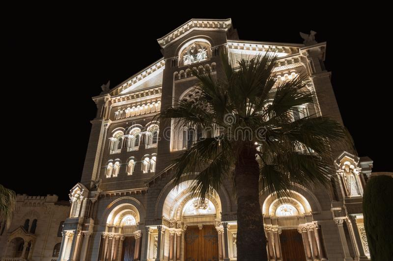 Monaco Cathedral in the night. Facade of the Monaco Cathedral of Our Lady Immaculate stock photo