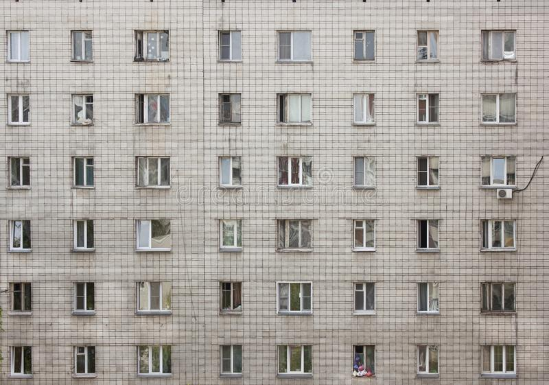 The facade of a multi-storey residential building of white brick royalty free stock photo