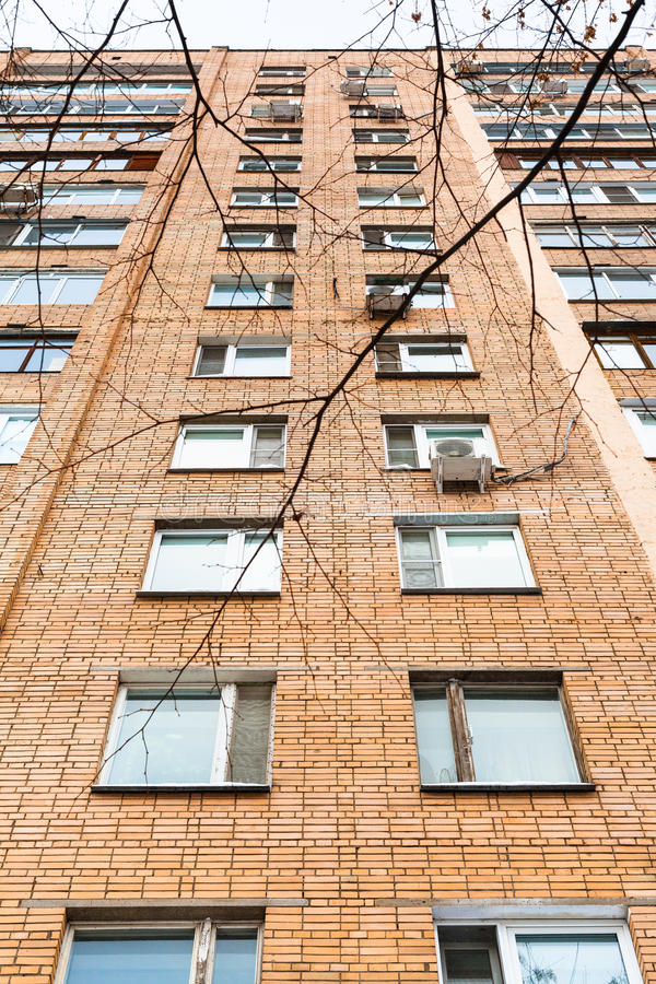 Facade of multistory brick apartment house. In winter day royalty free stock photos