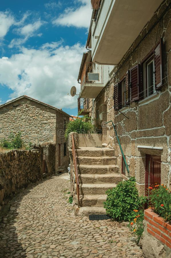 Facade of a stone house with staircase. Facade of a neat stone house with staircase on a cobblestone alley, in a sunny day at Alvoco da Serra. A cute village stock photos