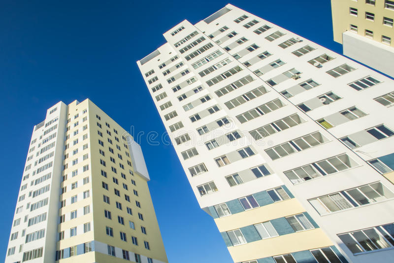 The facade of the new residential high-rise buildings against the sky . The concept of building a typical residential neighborhood stock image