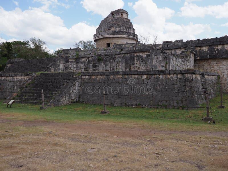 Facade of obserwatory at Chichen Itza mayan town at Mexico royalty free stock photos