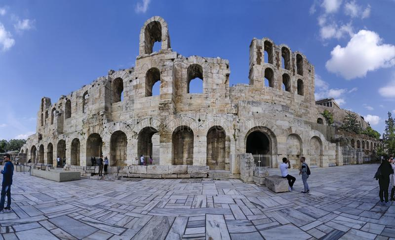 Facade of the Odeon of Herodes Atticus or Herodeon. It is a stone theater structure located on the southwest slope of the Acropo stock images