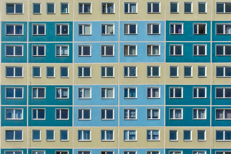 Facade of an old apartment block with many residential units stock image