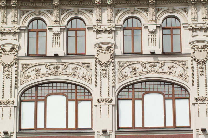 The facade of an old building with floral fretwork. Luxurious facade of a old historic building with a floral fretwork in St. Petersburg royalty free stock photography