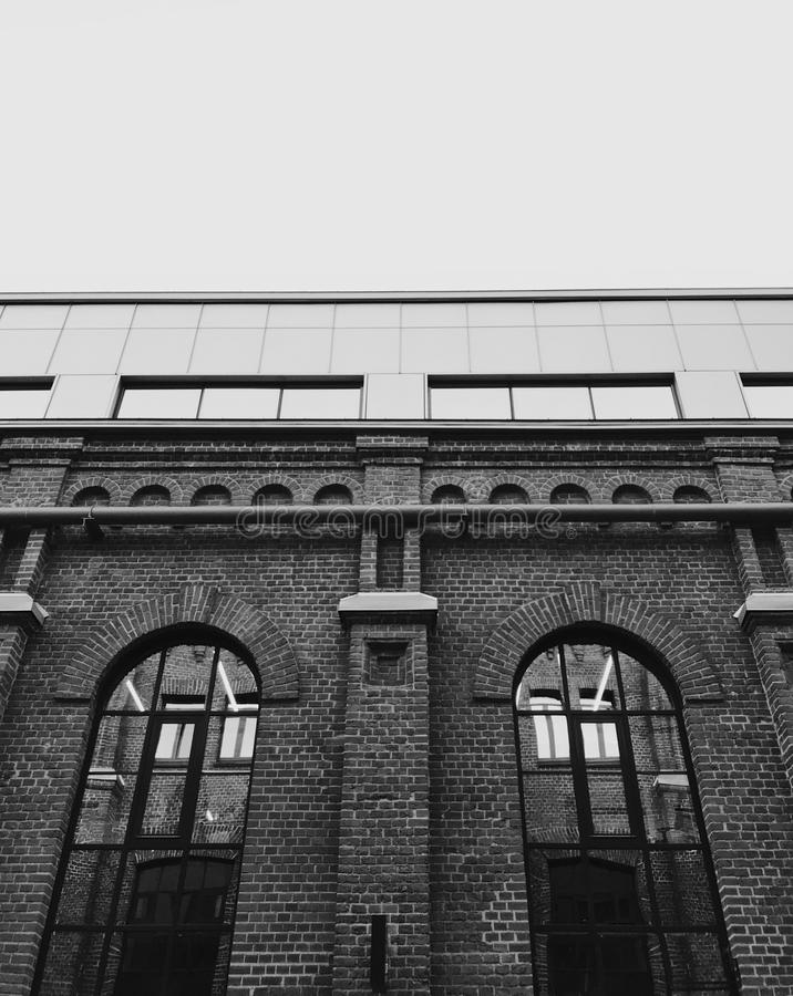 Facade of old building. Monochrome photo of old building facade in Moscow. Building has huge windows and roof of metal stock photos