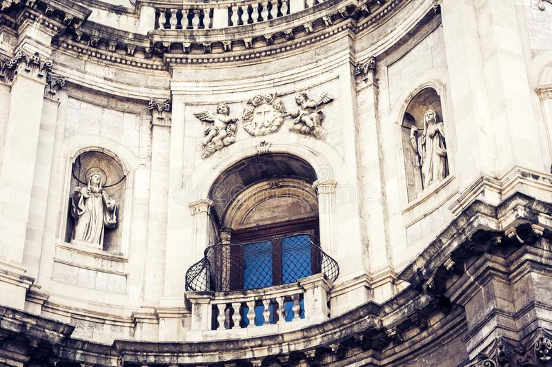 Facade of old cathedral on historical street of Catania, Sicily, Italy.  royalty free stock image