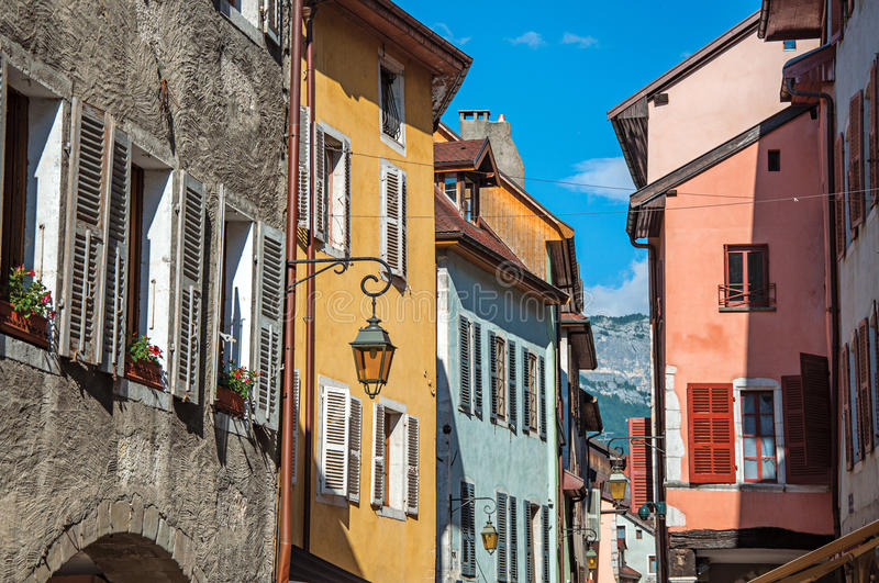 Facade of old and colorful buildings with windows in Annecy. Facade of old and colorful buildings with windows and blue sky in the background. City center of royalty free stock images