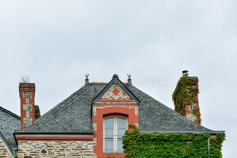 Facade of old colorful house, roof and attic window in Rochefort-en-Terre, French Brittany stock photos