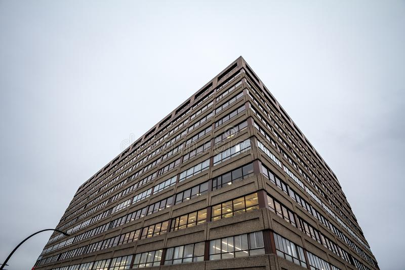 Facade of an old concrete industrial warehouse, office and factory building, north American style, in the suburbs of Montreal. Picture of the concrete facades stock photo