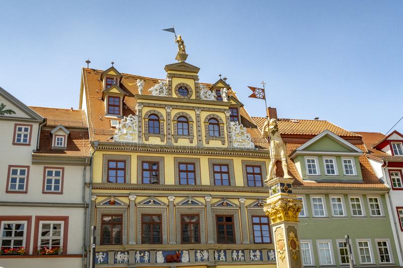 Facade old historic houses and statue in Erfurt stock photo