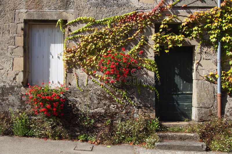 Download Facade Of An Old House, With Flowers Royalty Free Stock Photography - Image: 26595217